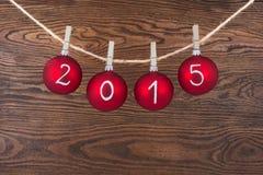 2015 Nieuwe jaartekst op Kerstmissnuisterijen Royalty-vrije Stock Fotografie
