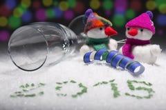 Nieuwe jarendecoratie met de Kerstman, sneeuwmens, champagnefluit Royalty-vrije Stock Afbeelding