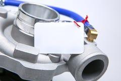 Nieuwe turbocompressor met het lege naambord op de rode kabel stock fotografie