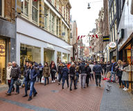 Nieuwendijk mensen. Crowded high street with many people shopping and carrying shopping bags Royalty Free Stock Photos
