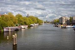 Nieuwevaart Canal in Amsterdam. Nieuwe Vaart (Nieuwevaart) 17th-century canal in the city of Amsterdam, Holland, the Netherlands Royalty Free Stock Photography