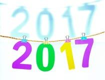 Nieuwjaar 2017 met schaduwaantal op witte achtergrond Stock Foto's