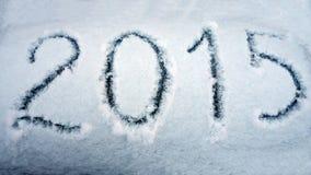 Nieuwjaar 2015 om op de sneeuw te schrijven Royalty-vrije Stock Afbeeldingen