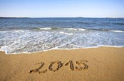 Nieuwjaar op het overzeese strand Stock Afbeelding