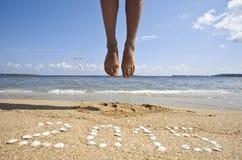 Nieuwjaar op het overzeese strand Stock Foto's