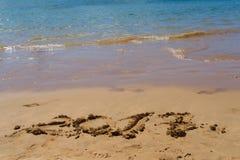 Nieuwjaar op het strand Stock Foto's
