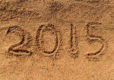 Nieuwjaar 2015 op zand Stock Afbeelding