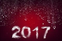 Nieuwjaar 2017 tekst met sneeuw wordt gemaakt die Royalty-vrije Stock Fotografie