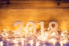 Nieuwjaarconcept voor 2018: Houten nummer 2018 op houten lijstbovenkant Stock Fotografie