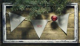 Nieuwjaarsamenstelling met decoratie oud kader Stock Foto's