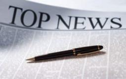 Nieuws op een krant Stock Foto