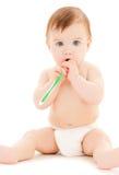 Nieuwsgierige baby het borstelen tanden Royalty-vrije Stock Afbeelding