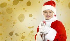 Nieuwsgierige Kerstmisjongen Stock Foto's