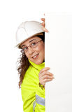 Nieuwsgierige vrouwelijke bouwvakker Stock Foto