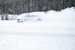 Nieve del espray de la deriva del coche Foto de archivo