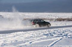 Nieve del espray de la deriva del coche Fotos de archivo
