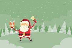 Nieve del invierno de la caja de Santa Claus Hold Bell Present Gift Foto de archivo libre de regalías