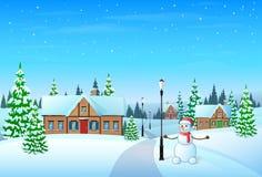 Nieve del invierno de la casa del pueblo del día de fiesta de la Navidad, Foto de archivo libre de regalías