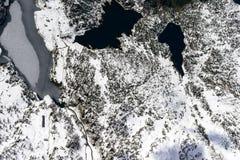 Nieve e hielo en el lago Marcio, Orobie, Italia Imagen de archivo libre de regalías