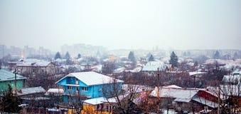 Nieve que cae abajo sobre la ciudad Fotografía de archivo libre de regalías