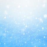 Nieve que cae del arte en el fondo azul Foto de archivo libre de regalías