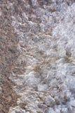 Nieve que derrite en rocas Fotos de archivo libres de regalías
