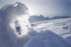 Nieve y luz del sol fotografía de archivo