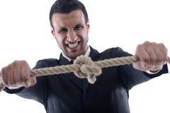 niewolna biznesowa mężczyzna ciągnięcia arkana wiążąca Zdjęcia Stock