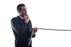 niewolna biznesowa mężczyzna ciągnięcia arkana wiążąca Obrazy Stock