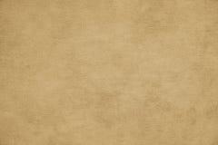 Niewygładzony koloru żółtego papieru tło Obrazy Stock