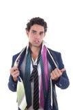 Niezdecydowany mężczyzna z udziałem krawaty wokoło jego szyi Obraz Royalty Free