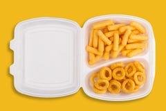 Niezdrowy łasowania pojęcie na kolorze żółtym Fotografia Stock