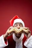 Niezdrowy je Święty Mikołaj Obrazy Royalty Free