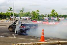 Niezidentyfikowanego kierowcy dryfujący samochód Fotografia Royalty Free