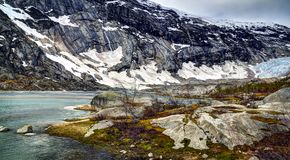 Nigardsbrevatnet jezioro i Nigardsbreen lodowiec Obrazy Stock