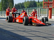 Nigel Manssel F1 Ferrari pushed. Ferrari 641 pushed back into the pit by 4 Ferrari crewmembers. This is the version Nigel Manssel drove during the F1 world Royalty Free Stock Image