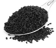 Nigella or Black with a silver spoon Stock Photo