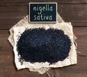 Nigella sativa or Black cumin with small chalkboard Stock Photography