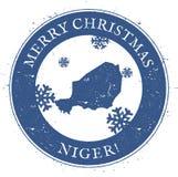 Niger översikt Glad jul Niger Stamp för tappning Arkivbild
