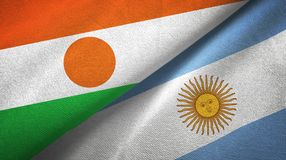 Niger and Argentina two flags textile cloth, fabric texture. Niger and Argentina flags together textile cloth, fabric texture royalty free illustration