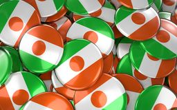 Niger Badges Background - Pile of Nigerien Flag Buttons. Stock Photography