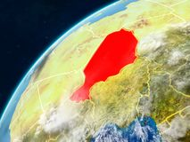 Niger on Earth with borders. Niger on realistic model of planet Earth with country borders and very detailed planet surface and clouds. 3D illustration. Elements stock photo