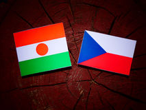 Niger flag with Czech flag on a tree stump  Stock Images
