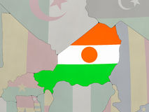 Niger with flag on globe Royalty Free Stock Photo