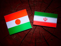 Niger flag with Iranian flag on a tree stump isolated Royalty Free Stock Photography
