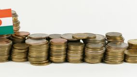 Niger flag with stack of money coins. Niger flag waving with stack of money coins stock footage