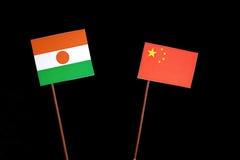 Niger flaga z chińczyk flaga na czerni zdjęcie royalty free