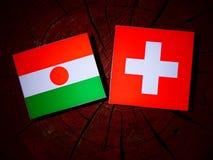 Niger flaga z szwajcarem zaznacza na drzewnym fiszorku obraz royalty free