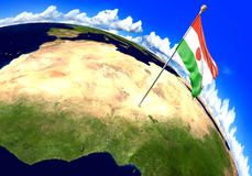 Niger national flag marking the country location on world map. 3D rendering, parts of this image furnished by NASA Stock Images
