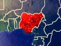 Nigeria auf Erde nachts stockbilder